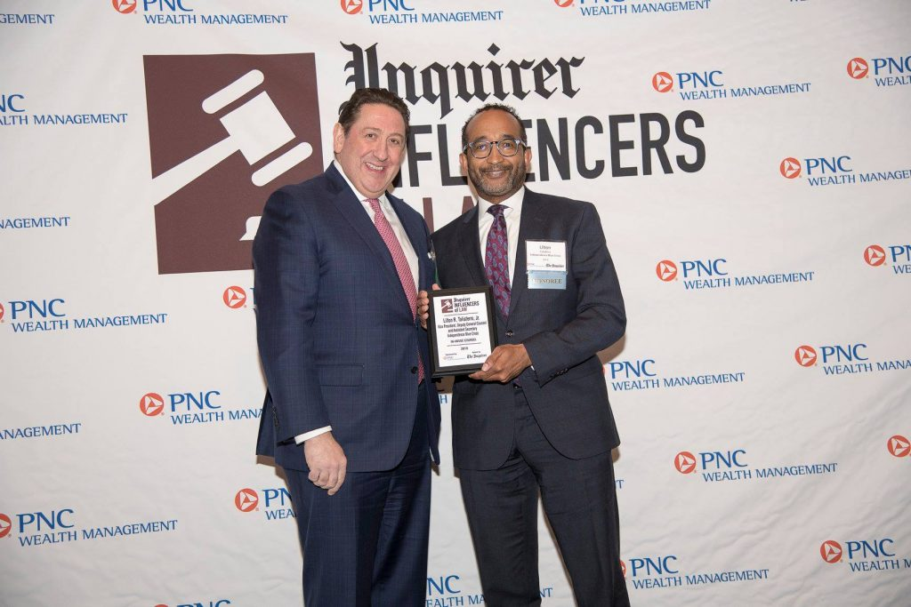 from left to right: Salvatore J. Patti from PNC Wealth Management standing with Tony Taliaferro of Independence Blue Cross, who is holding his Influencers of Law award