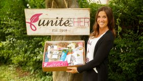 Unite for HER Founder and CEO Sue Weldon with HER care box