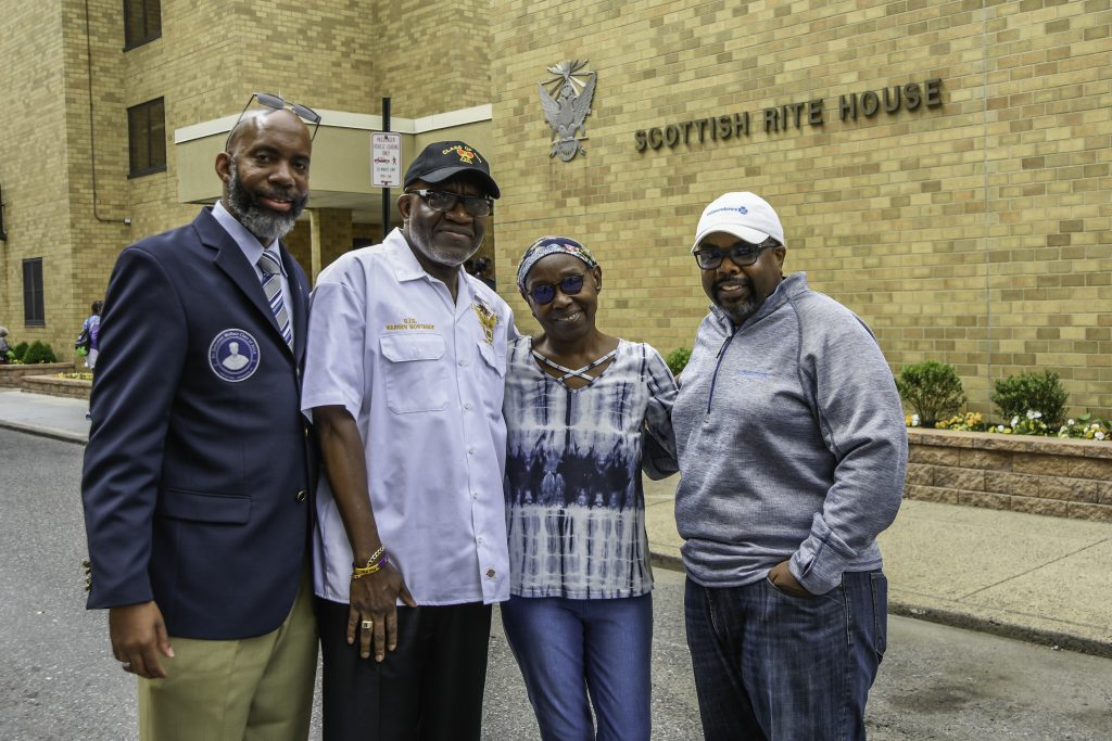 Pictured from left to right: Adam Jones and Warren Montague of the Scottish Rite; Ruth Lewis, community resident; and Kenyatta D. Donley of Independence Blue Cross