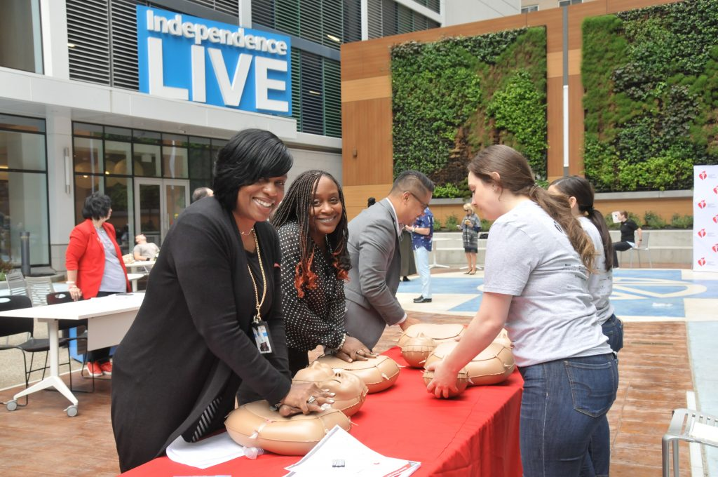 IBX associates practice Hands-Only CPR on training manikins in the Market Street Courtyard outside of Independence LIVE