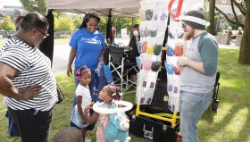 Two women, a man, and three children enjoy the 2018 PCOM Wellness Fest.