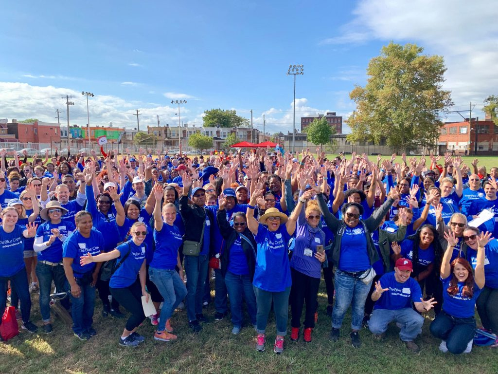 300 volunteers in blue IBX Blue Crew T-shirts at McVeigh Recreation Center on Day of Caring 2019