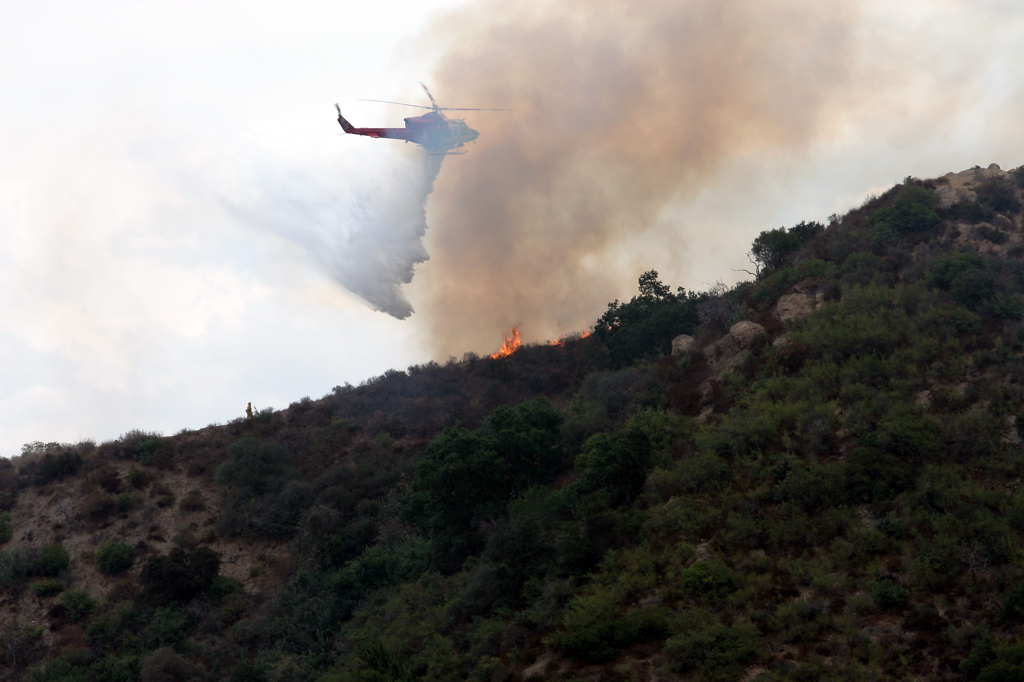 LA City Fire Department Helicopter droping water on a fire in the Hollywood Hills.