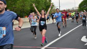 Candid shot of woman running Blue Cross Broad Street run