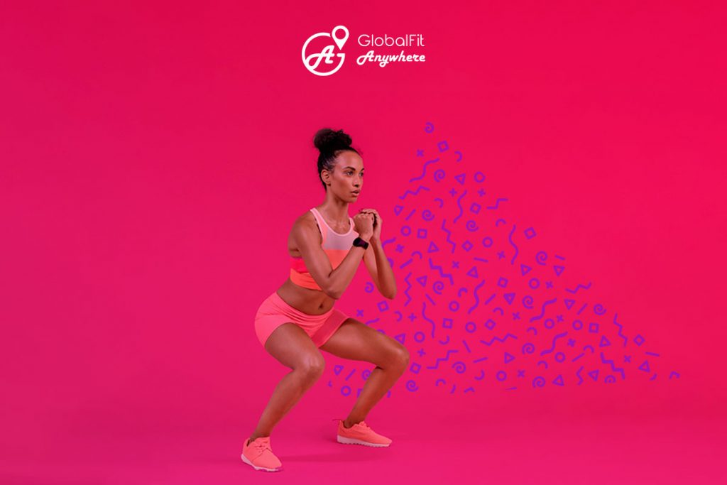 Image of woman doing squat with GlobalFit logo overlay