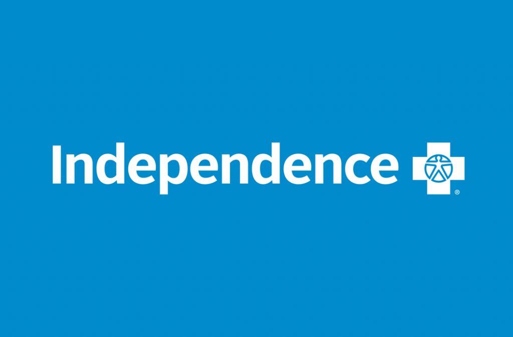 white Independence Blue Cross logo on blue background