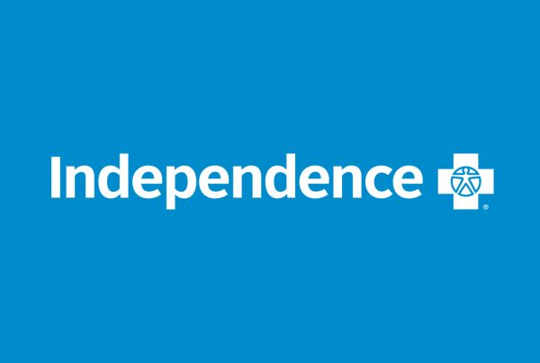 white Independence Blue Cross logo on blue background