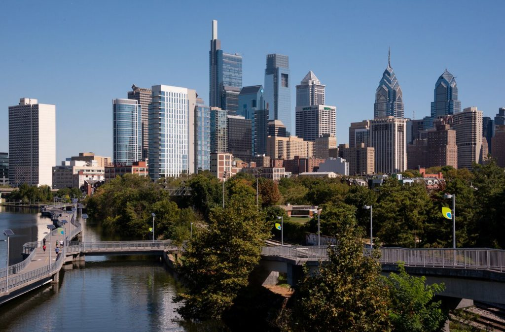 Philadelphia skyline on a clear day as viewed from the South Street Bridge facing the G. Fred DiBona Building